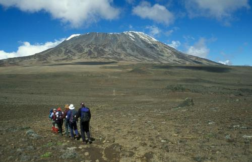 group-of-walkers-heading-for-the-snow-capped-mount-kilimanjaro-tanzania-africa-1600x1031